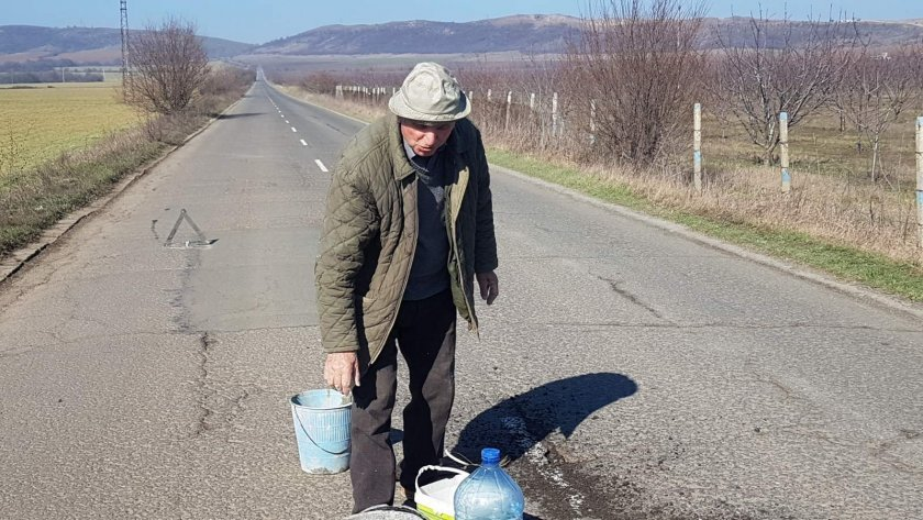 81 year old man on a mission to fill potholes on the road between two villages